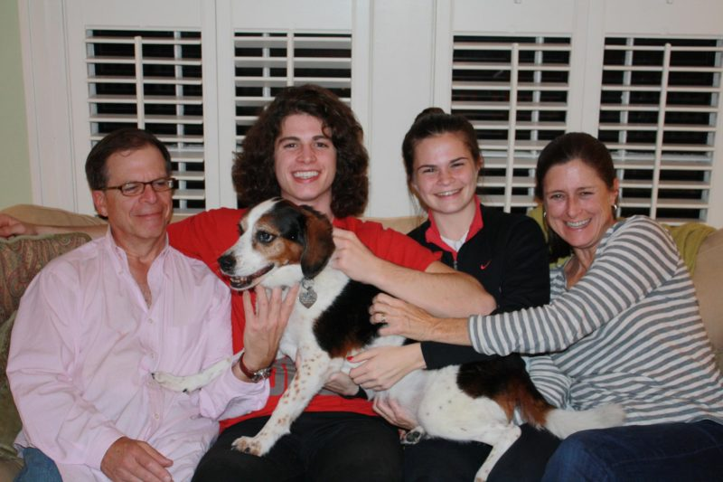 Our family and our dog Clarissa sitting on the couch